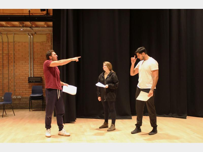 Drama students rehearsing in class