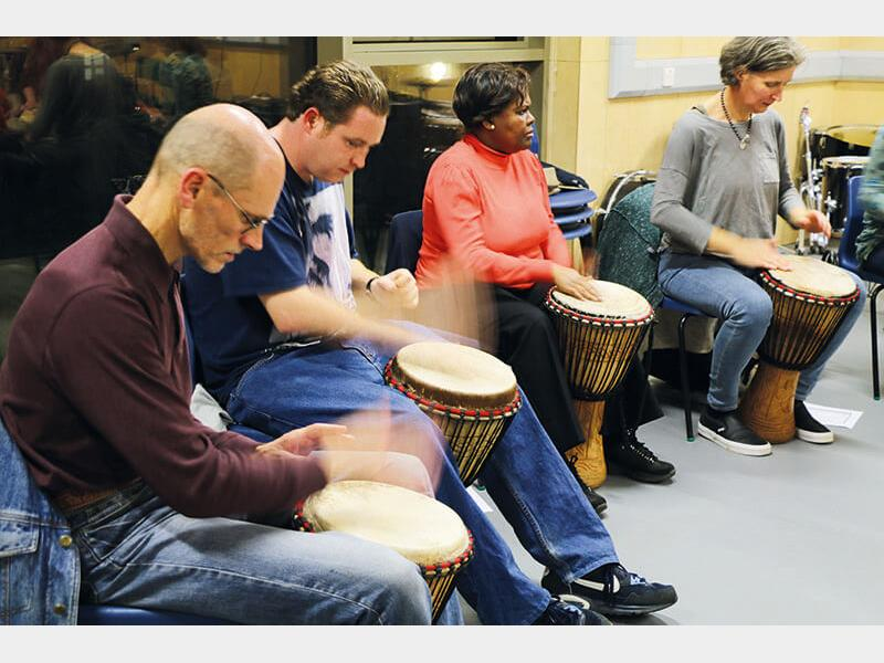 Drumming students in class