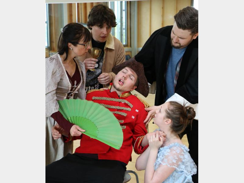 Drama students performing a dress rehearsal