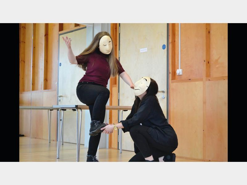 Drama students doing mask work class