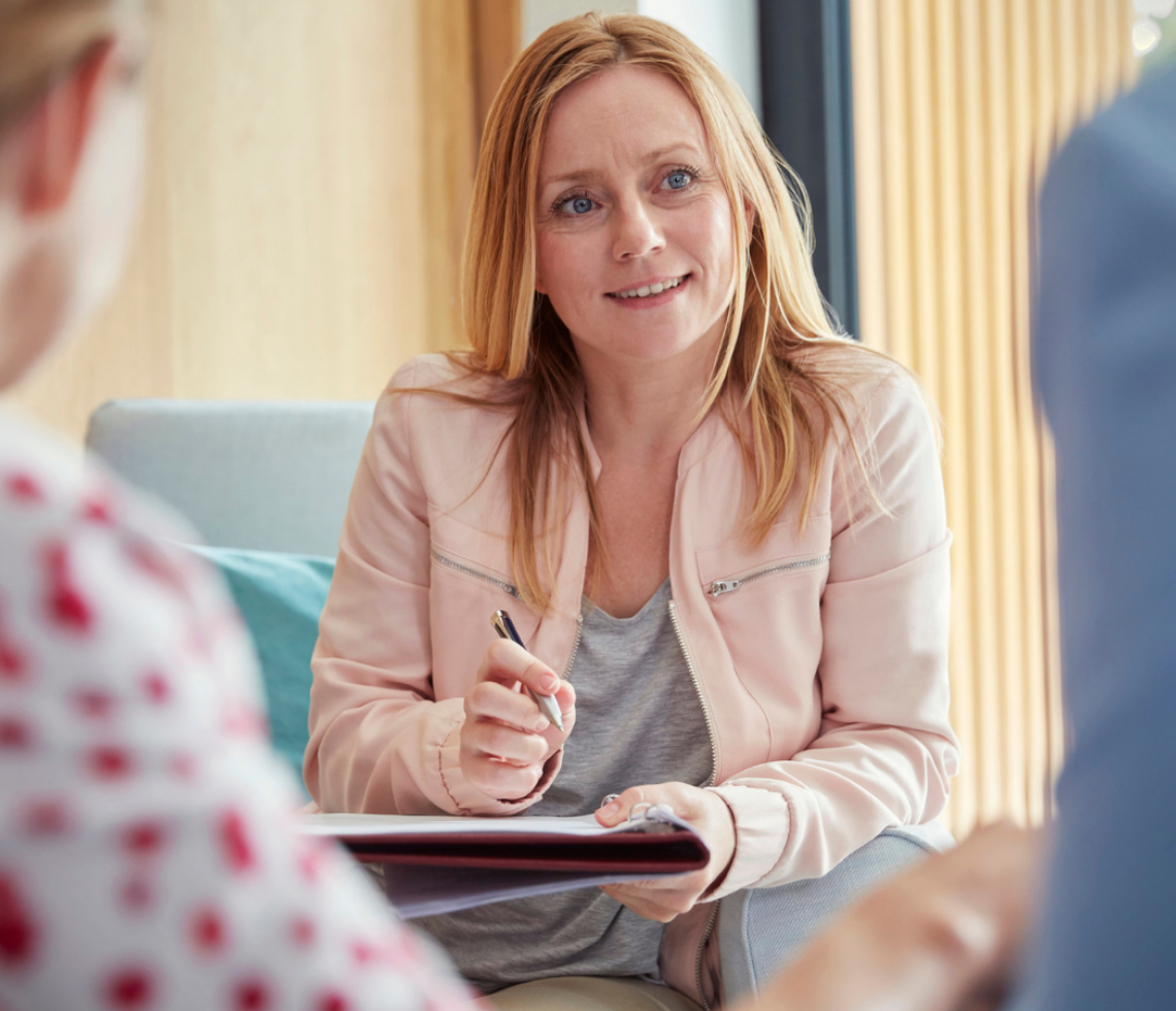 Counselling lady sat with male and female