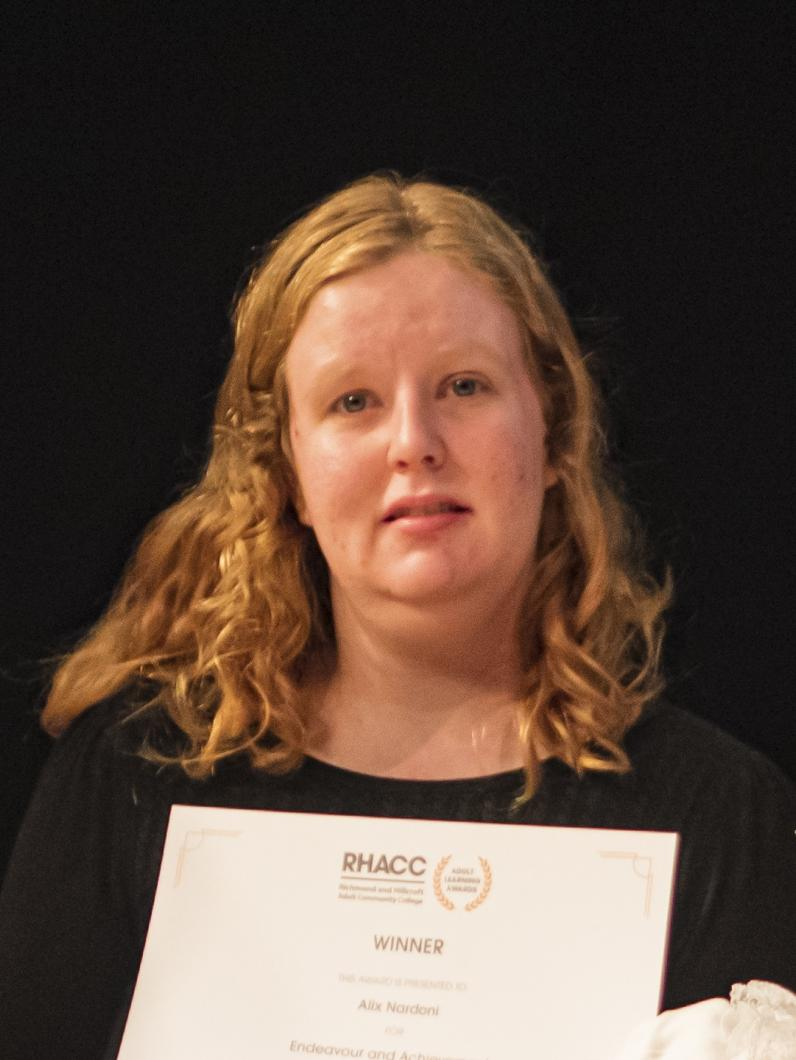 Female learner holding certificate